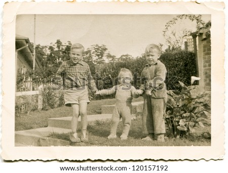 Vintage photo of children (fifties) - stock photo