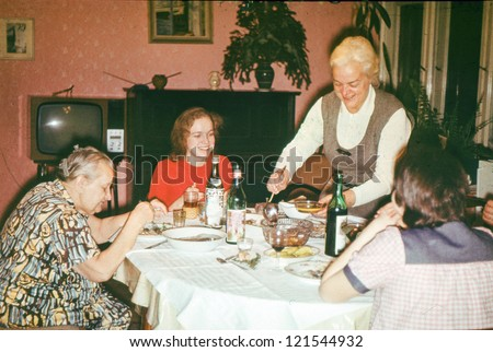 Vintage photo of Christmas eve family dinner (early seventies) - stock photo