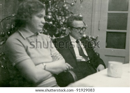 Vintage photo of couple at Christmas time (fifties) - stock photo