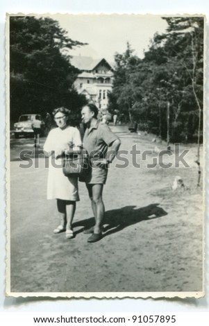 Vintage photo of couple (sixties) - stock photo