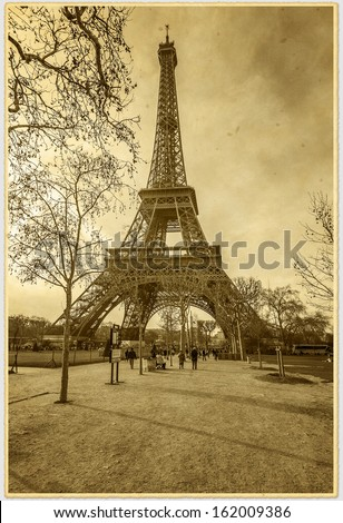 Vintage photo of Eiffel Tower (See original photo ID: 146193581). Eiffel Tower located on Champ de Mars in Paris is tallest structure in Paris and most visited monument in the world. France. - stock photo
