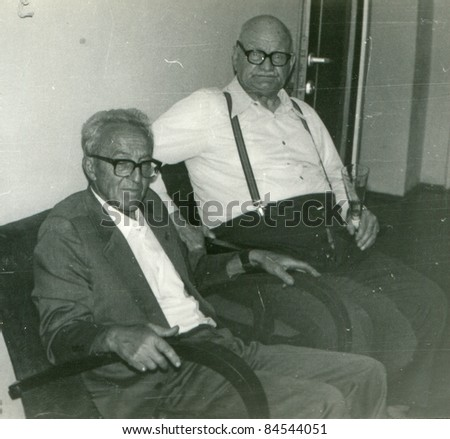 Vintage photo of elderly men - stock photo