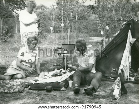 Vintage photo of family camping (sixties) - stock photo