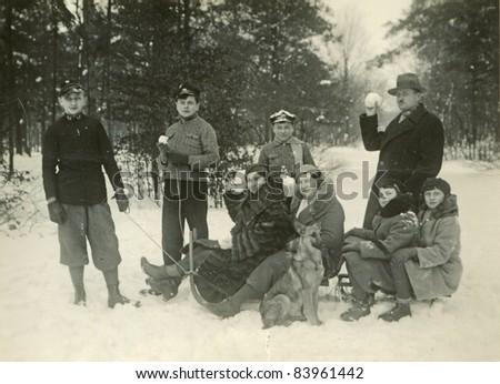 Vintage photo of family enjoying snow (thirties) - stock photo