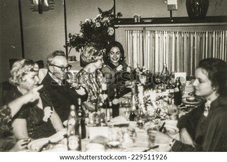 Vintage photo of family party - eighties - stock photo