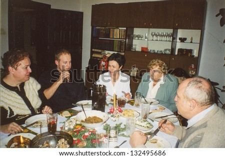 Vintage photo of family party (seventies) - stock photo