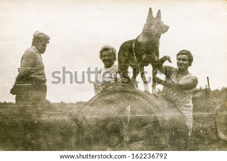 Vintage photo of family with a dog, fifties - stock photo