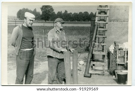 Vintage photo of farmers (fifties) - stock photo