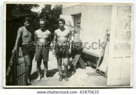 Vintage photo of father and sons (sixties)
