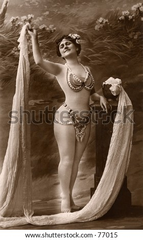 Vintage photo of female performer in costume, circa 1900 - stock photo
