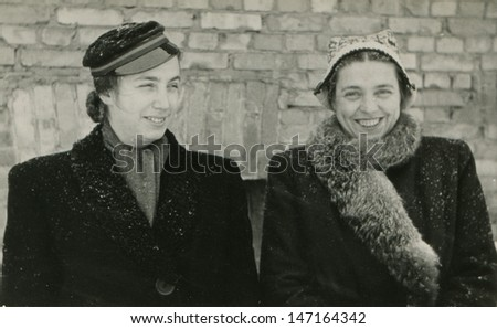 Vintage photo of female student with her mother, 1948 - stock photo