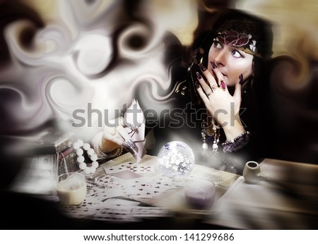Vintage photo of fortune teller frightened of a ghost - stock photo