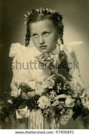 Vintage photo of girl - first communion, thirties - stock photo