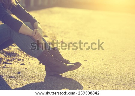 Vintage photo of girl's legs and boots - stock photo