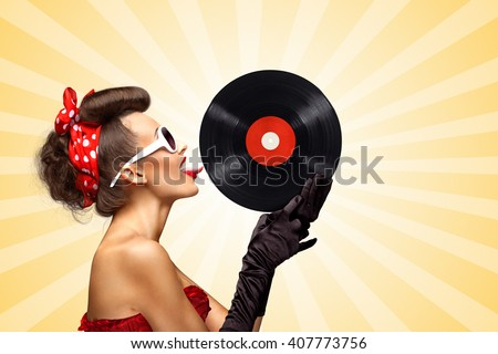 Vintage photo of glamorous pinup girl wearing long gloves, red ribbon in her hair and sunglasses, touching retro vinyl with her tongue on colorful abstract cartoon style background.