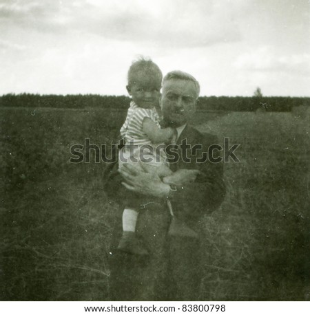 Vintage photo of grandfather with granddaughter (fifties) - stock photo