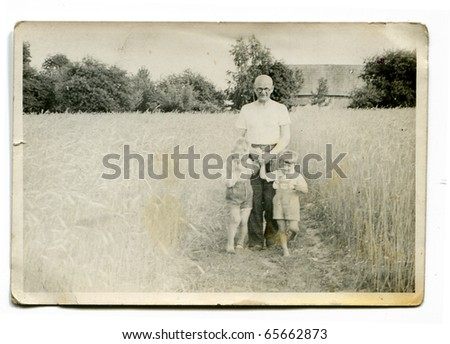 Vintage photo of grandfather with grandsons - stock photo
