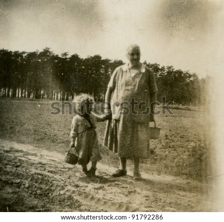 Vintage photo of grandmother with granddaughter (fifties) - stock photo