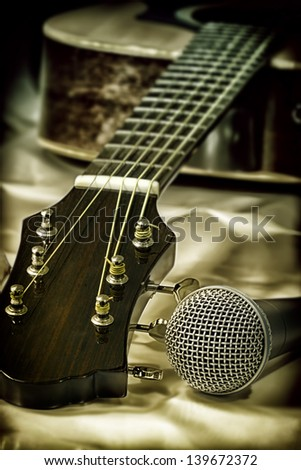 Vintage photo of guitar and microphone - stock photo