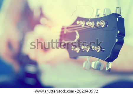 Vintage photo of guitarist on stage in the stagelight - stock photo