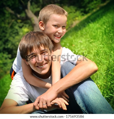 Vintage photo of happy teenager and kid outdoor - stock photo