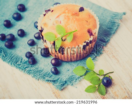 vintage photo of Homemade blueberry muffins - stock photo