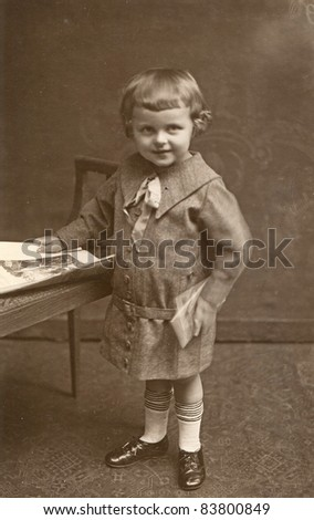 Vintage photo of little girl (1926) - stock photo