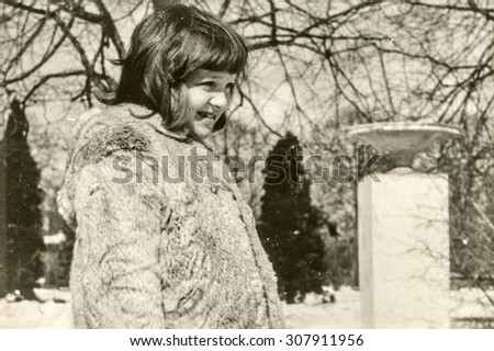 Vintage photo of little girl, early 1960's - stock photo