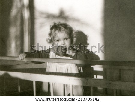 Vintage photo of little girl (fifties) - stock photo