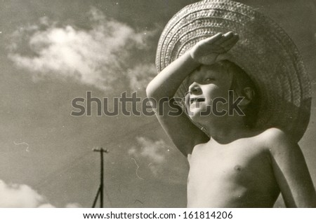 Vintage photo of little girl in straw hat - fifties - stock photo