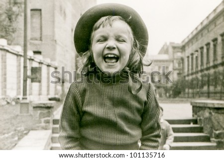 Vintage photo of little girl laughing (fifties) - stock photo