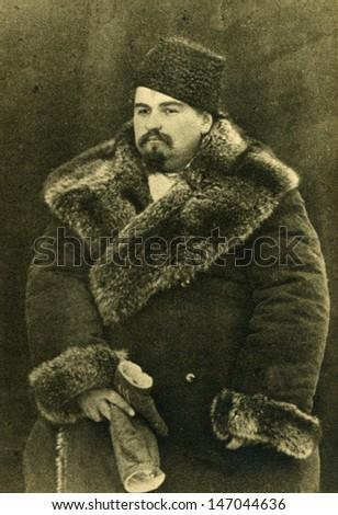 Vintage photo of man 1900 - stock photo