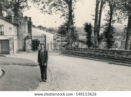 Vintage photo of man in front of his house, fifties - stock photo