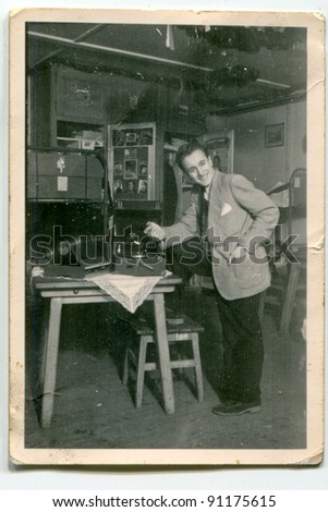Vintage photo of man with a gramophone (forties)