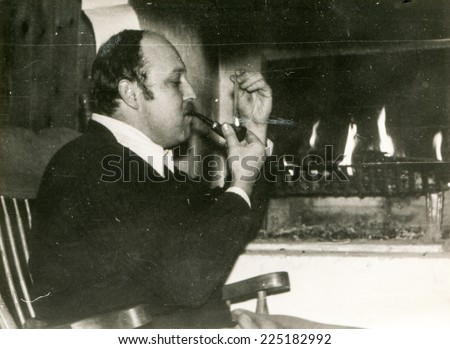 Vintage photo of man with a pipe, early eighties - stock photo