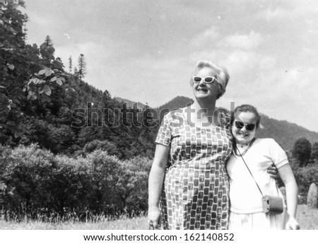 Vintage photo of mother and daughter, fifties