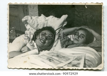 Vintage photo of mother and daughter in bed (fifties) - stock photo