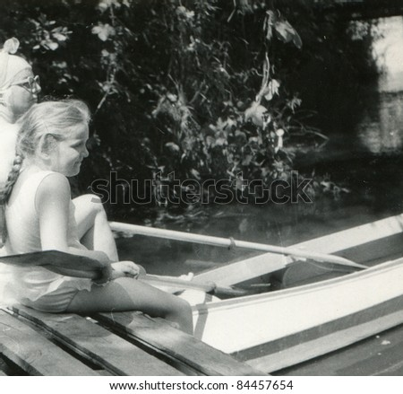 Vintage photo of mother and daughter kayaking (fifties)