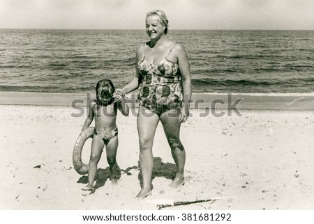 Vintage photo of mother and daughter on beach, 1958 (note for reviewer: it is my deceased mother and myself as a kid)