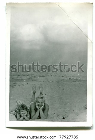 Vintage photo of mother and daughter outdoor (fifties) - stock photo