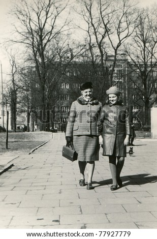 Vintage photo of mother and daughter outdoor (sixties) - stock photo