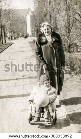 Vintage photo of mother and daughter, 1950's - stock photo