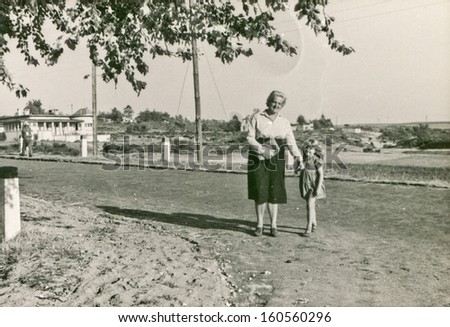 Vintage photo of mother and daughter, sixties - stock photo
