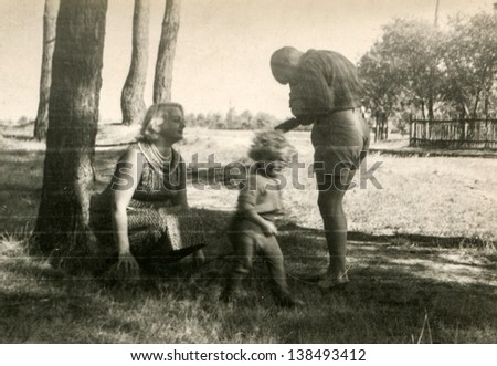 Vintage photo of mother, son and daughter (fifties) - stock photo