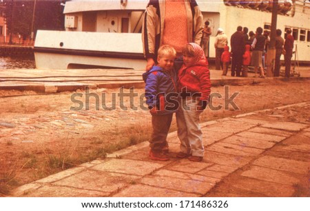 Vintage photo of mother with little children, early eighties - stock photo