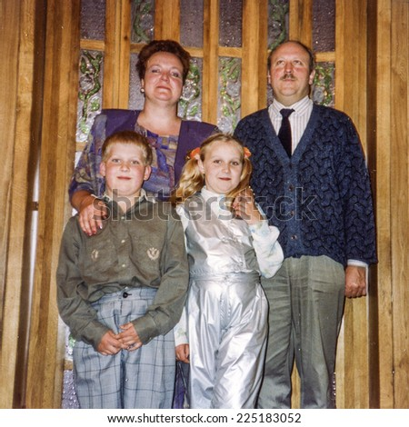 Vintage photo of parents with daughter and son, eighties - stock photo