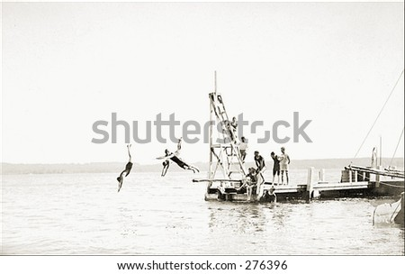 Vintage Photo of People Diving Into Water - stock photo