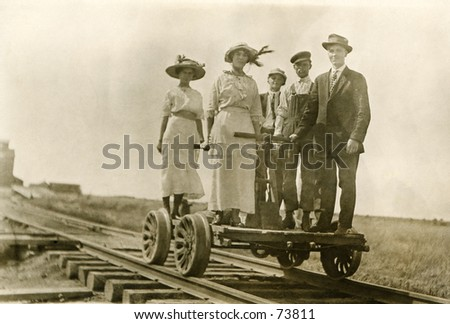 Vintage photo of people on a railroad handcart - stock photo