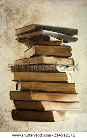 Vintage photo of pile of old books - stock photo