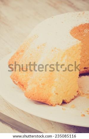 vintage photo of Round-shaped tasty lemon cake - stock photo